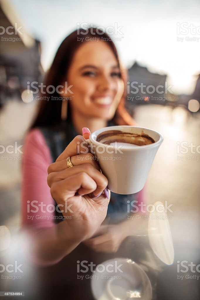 Close up of a woman holding espresso coffee. stock photo