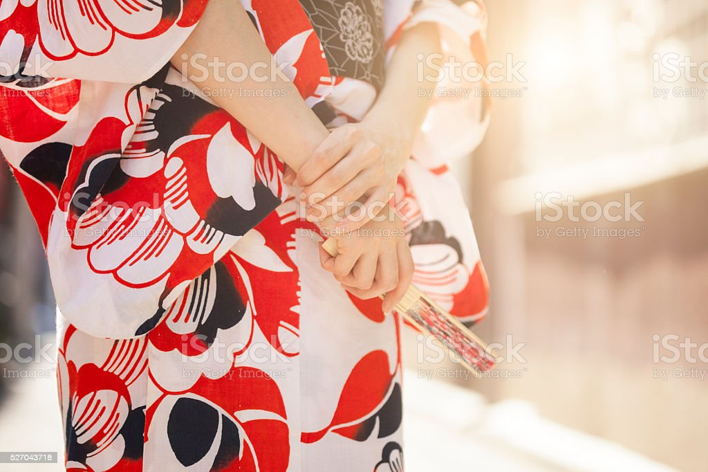 Close up of a woman in kimono holding fan stock photo