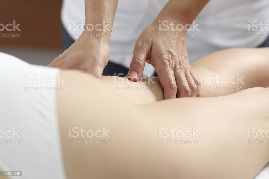 Close up of a woman legs receiving massage stock photo