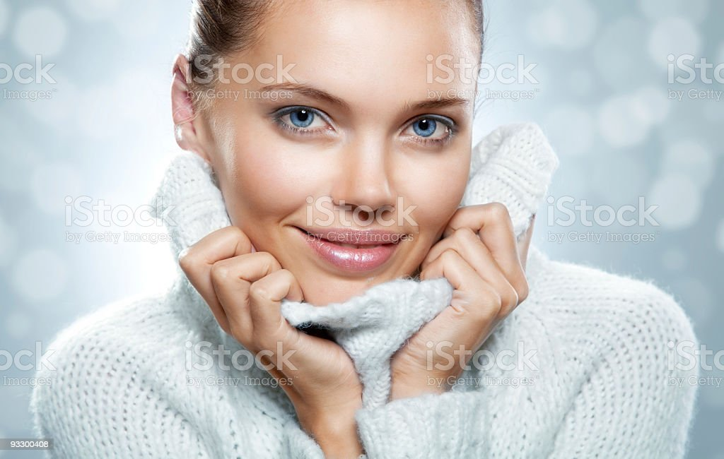 A close up of a woman wearing a sweater royalty-free stock photo