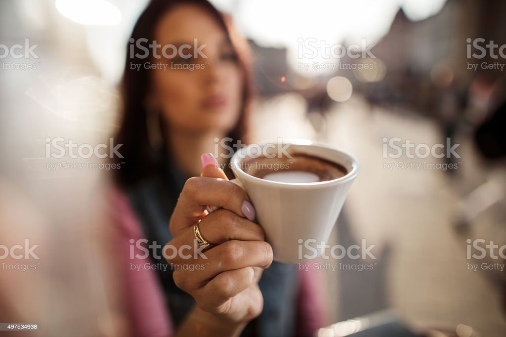 Close up of a woman with espresso coffee at cafe. stock photo