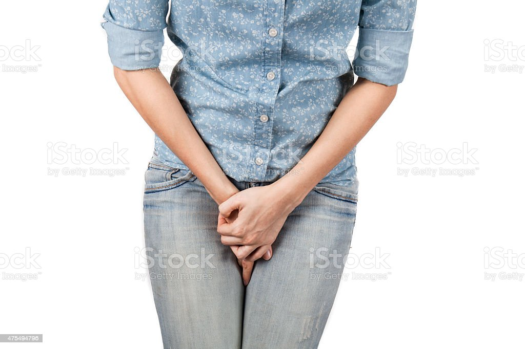 Close up of a woman with hands holding her crotch stock photo