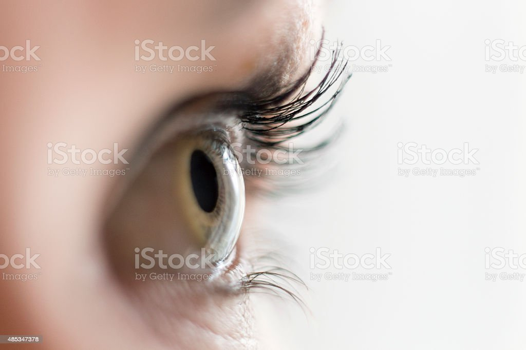 Close up of a woman's eye looking aside stock photo