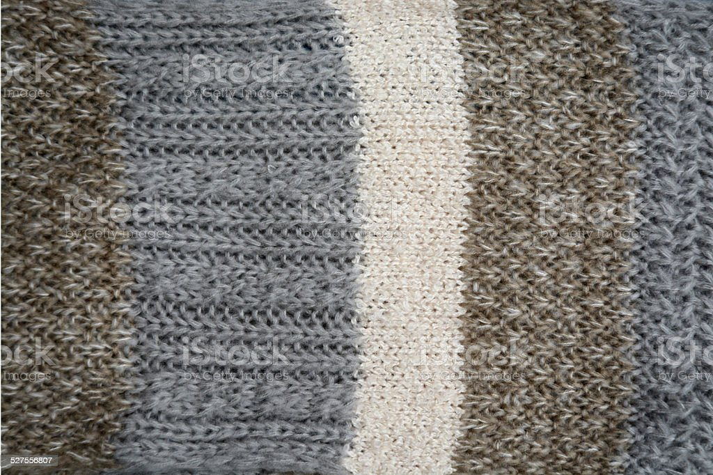 close up of a wool knitted scarf in natural colors stock photo