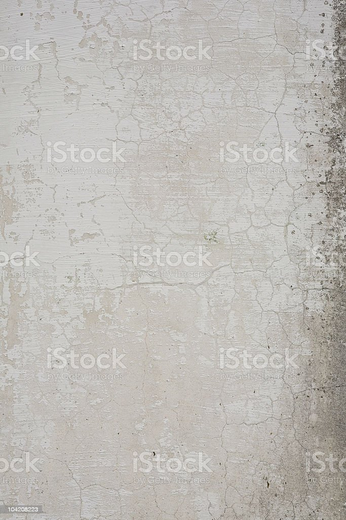 Close up of a worn and weathered concrete wall royalty-free stock photo