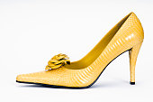 Close up of a yellow high heel shoe