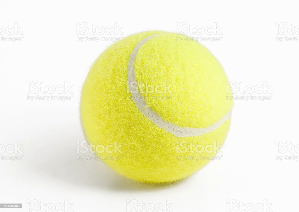 A close up of a yellow tennis ball royalty-free stock photo