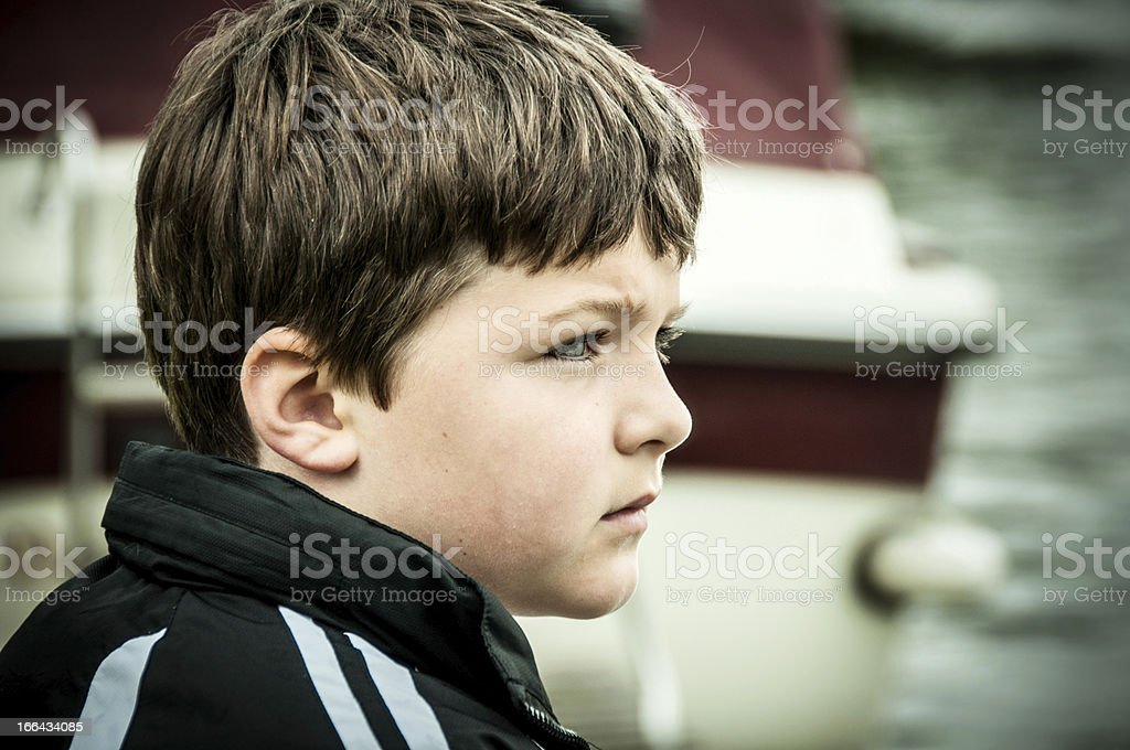 Close up of a young boy contemplating royalty-free stock photo