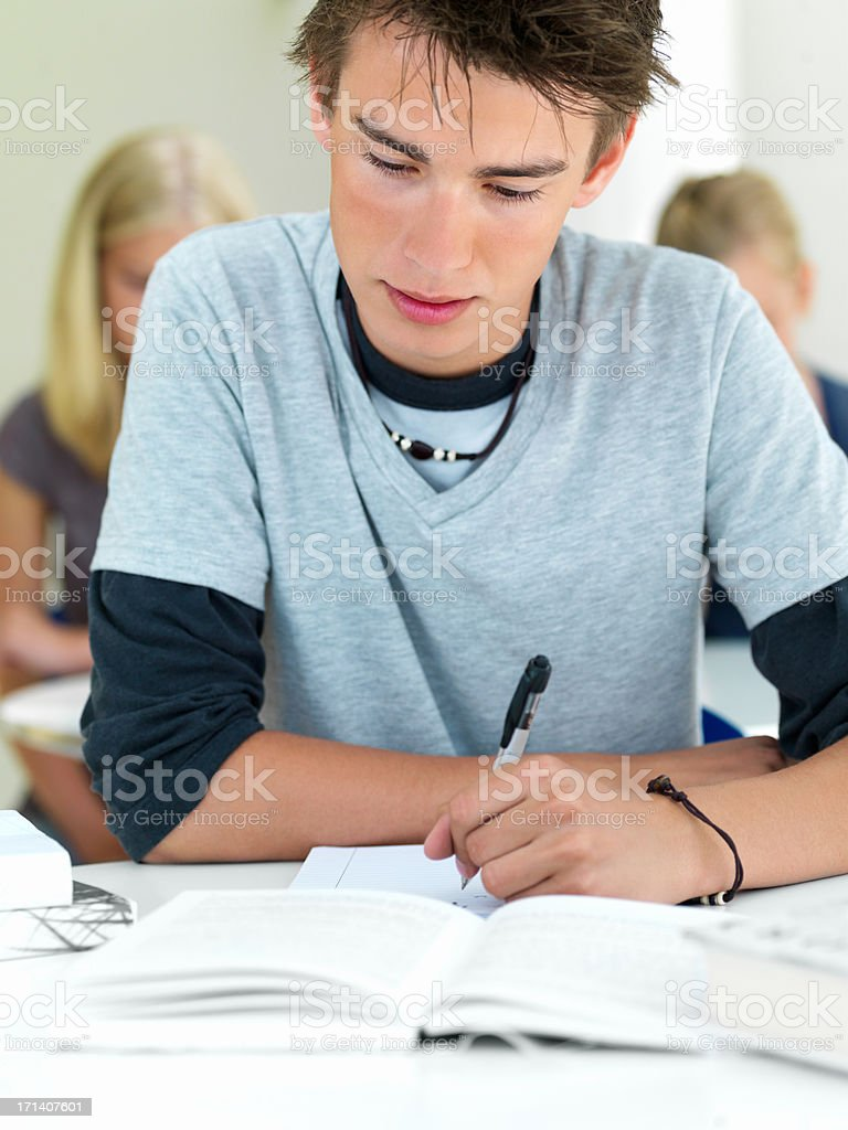 Close up of a young boy looking in book royalty-free stock photo