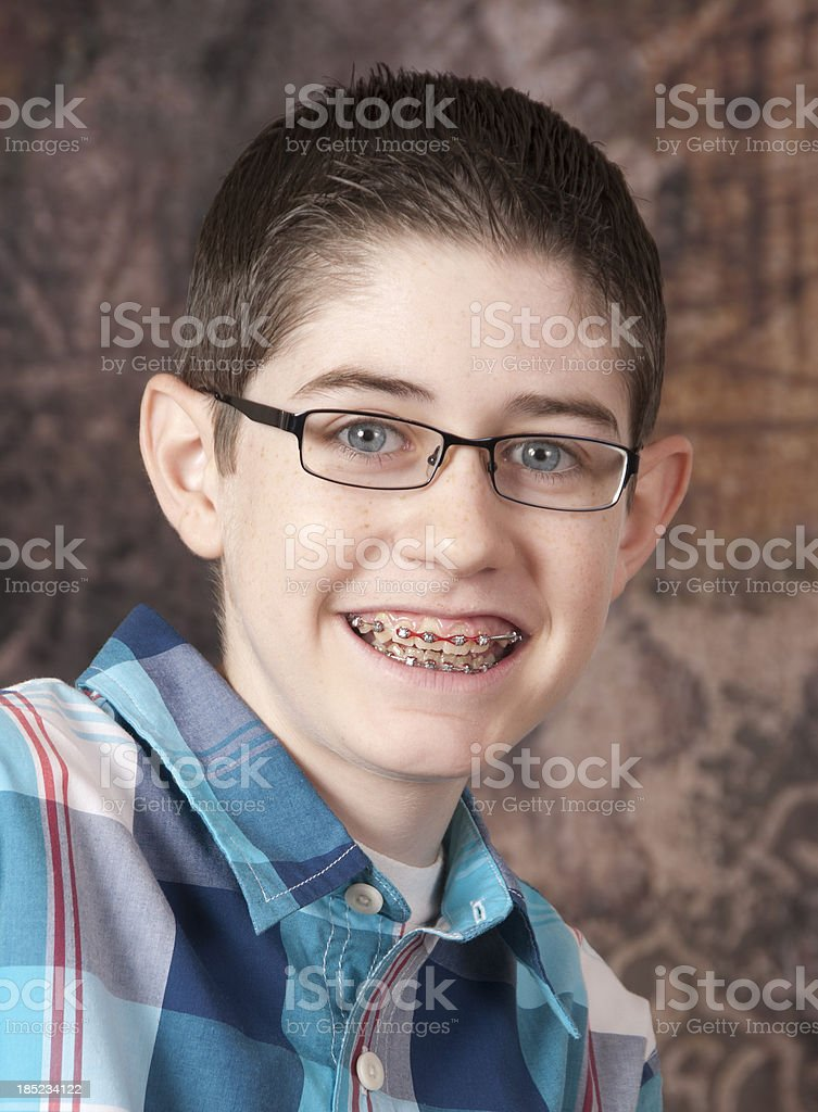 Close up of a young boy with glasses and braces royalty-free stock photo
