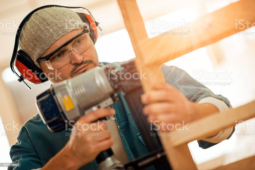 Close up of a young carpenter at work stock photo