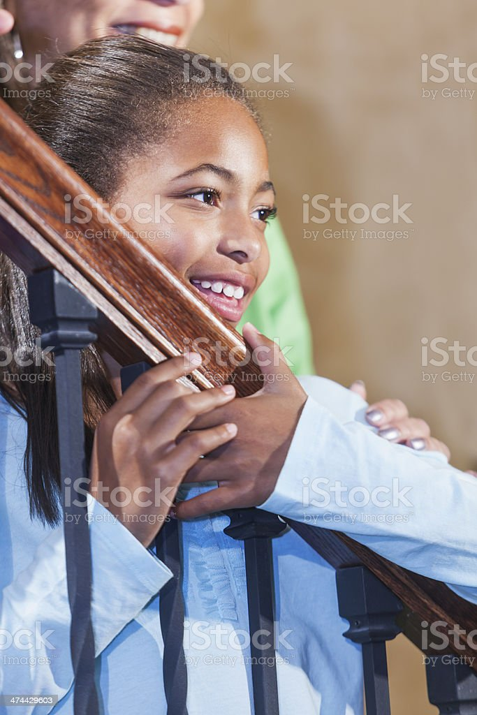 Close up of African American girl standing on stairs stock photo