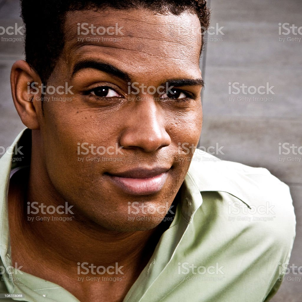 Close up of African American man in a green shirt stock photo