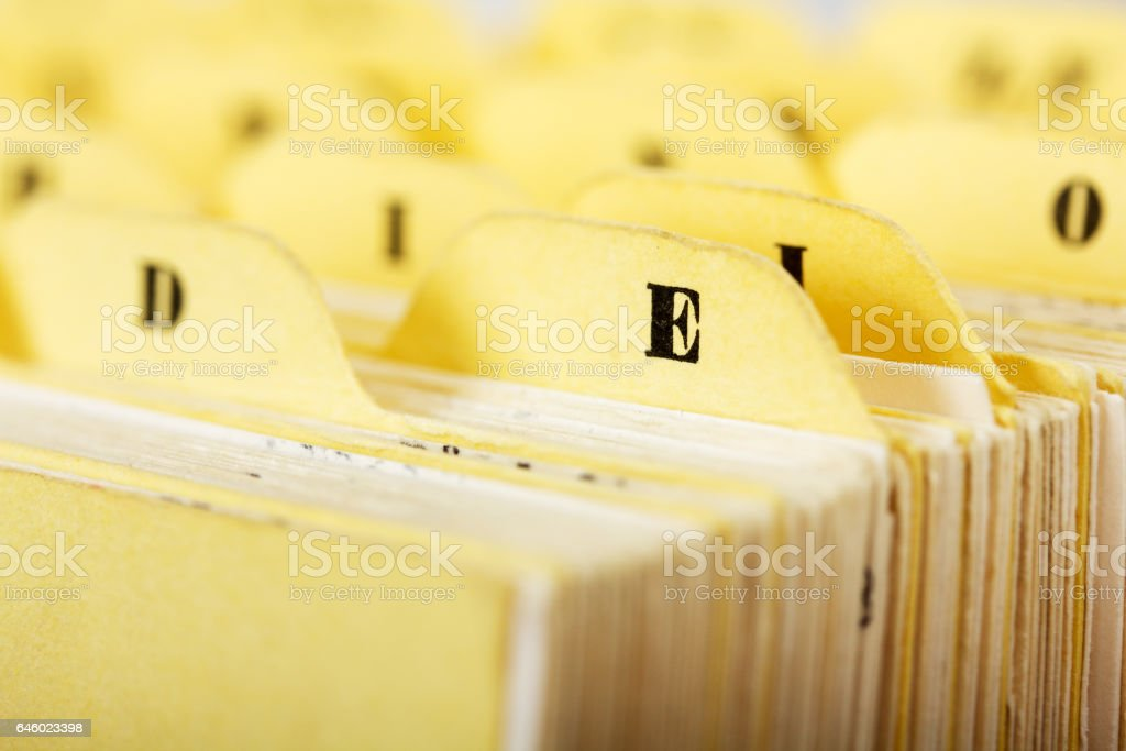 Close up of alphabetical index cards in a box