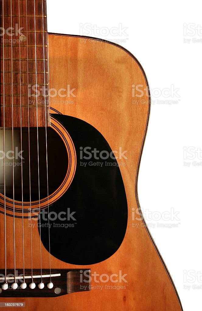 A close up of an acoustic guitar stock photo