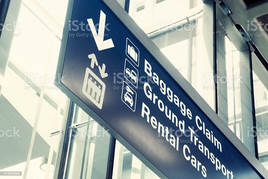 Close up of an airport exit sign stock photo