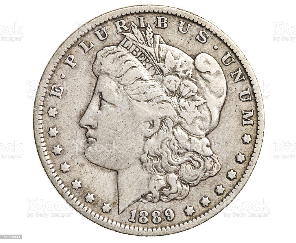 A close up of an antique silver dollar stock photo