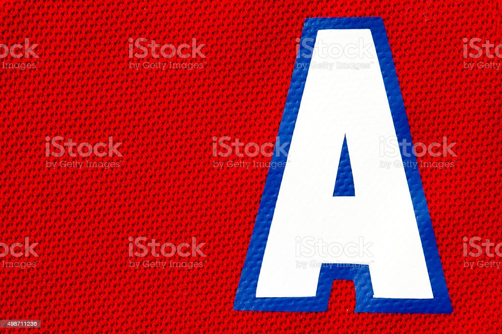 Close up of an Assistant Captain hockey jersey patch stock photo