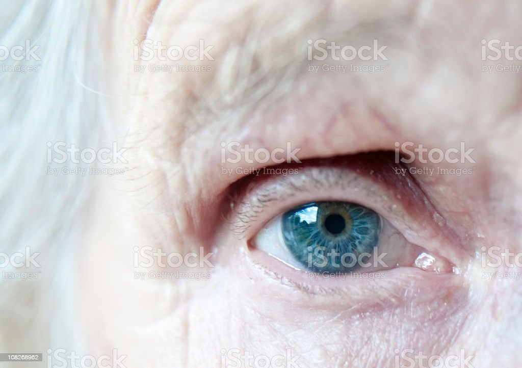 Close Up Of An Elderly Ladies Blue Eye stock photo