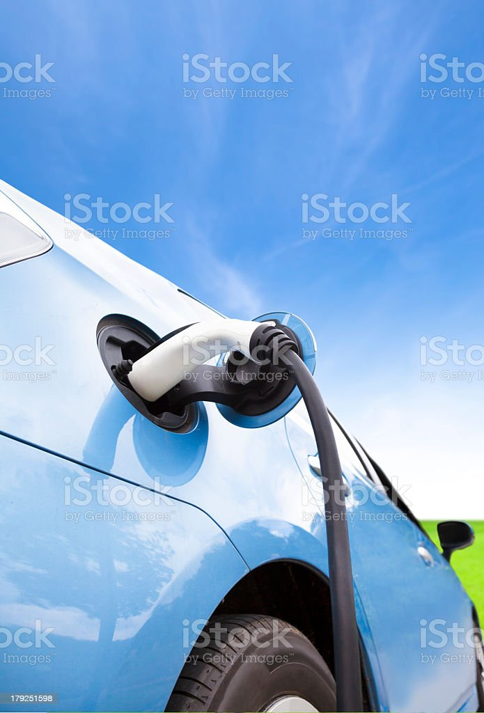 Close up of an electric car being charged stock photo