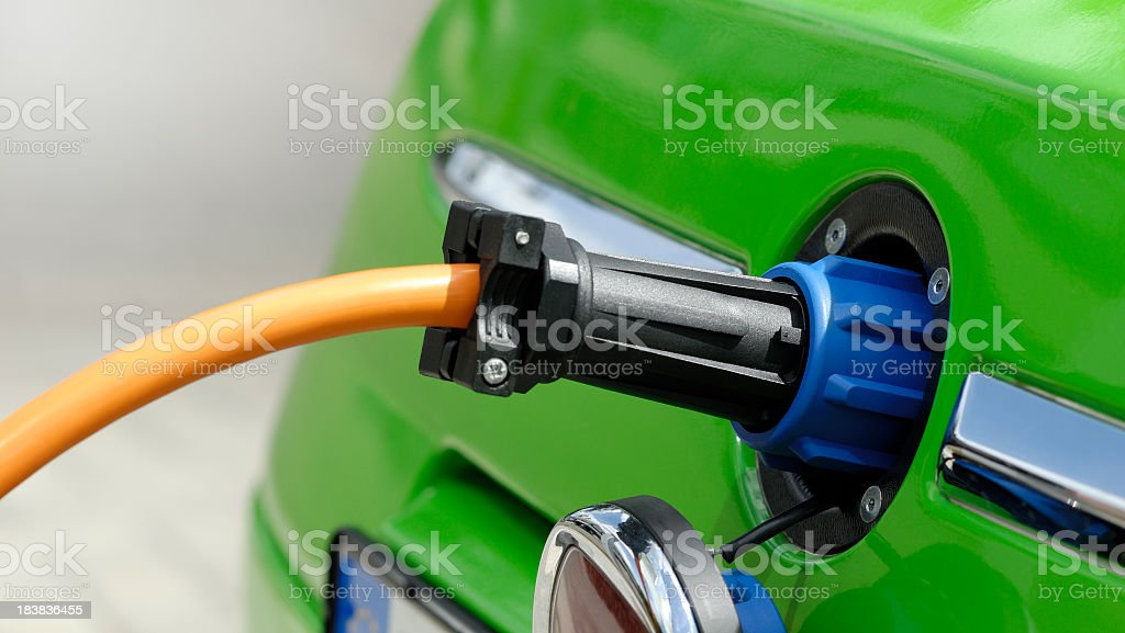 Close up of an electric car plugged in to charge royalty-free stock photo