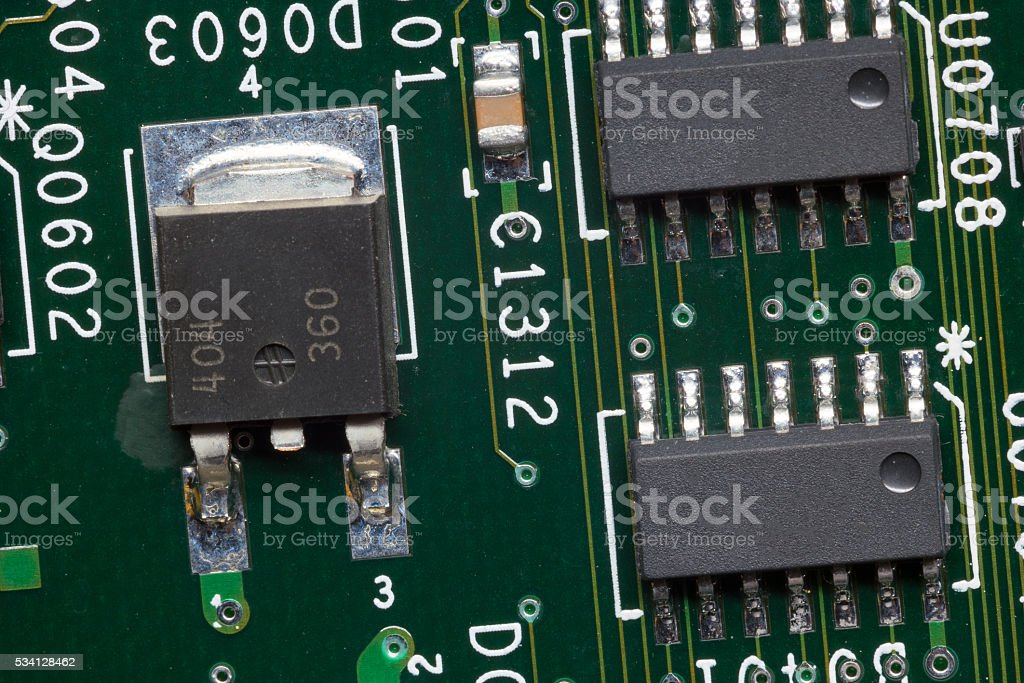 Close up of an electronic circuit board. stock photo