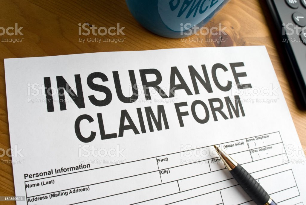 Close up of an Insurance Claim Form on a desk royalty-free stock photo