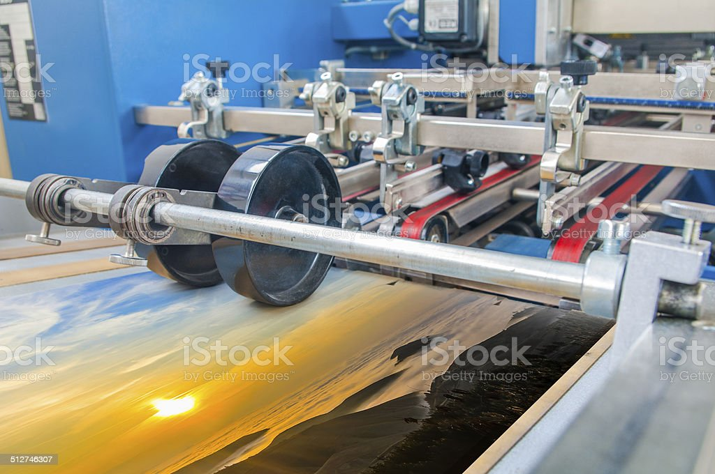 Close up of an offset printing machine during production stock photo