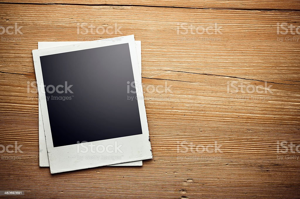 close up of an old photo on a wooden background stock photo