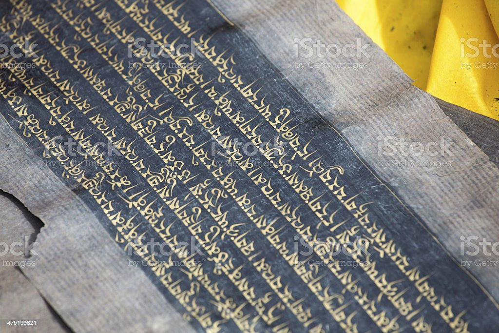 Close up of an old Tibetan manuscript in Tibet royalty-free stock photo