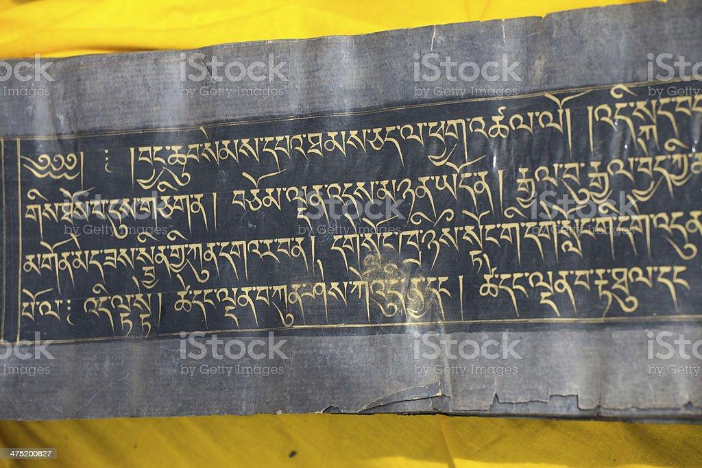 Close up of an old Tibetan manuscript in Tibet royalty-free stock photo