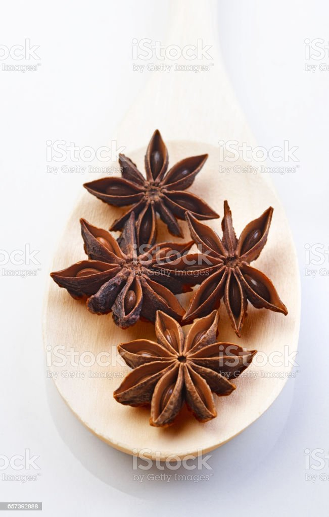 Close up of anise on wooden spoon stock photo