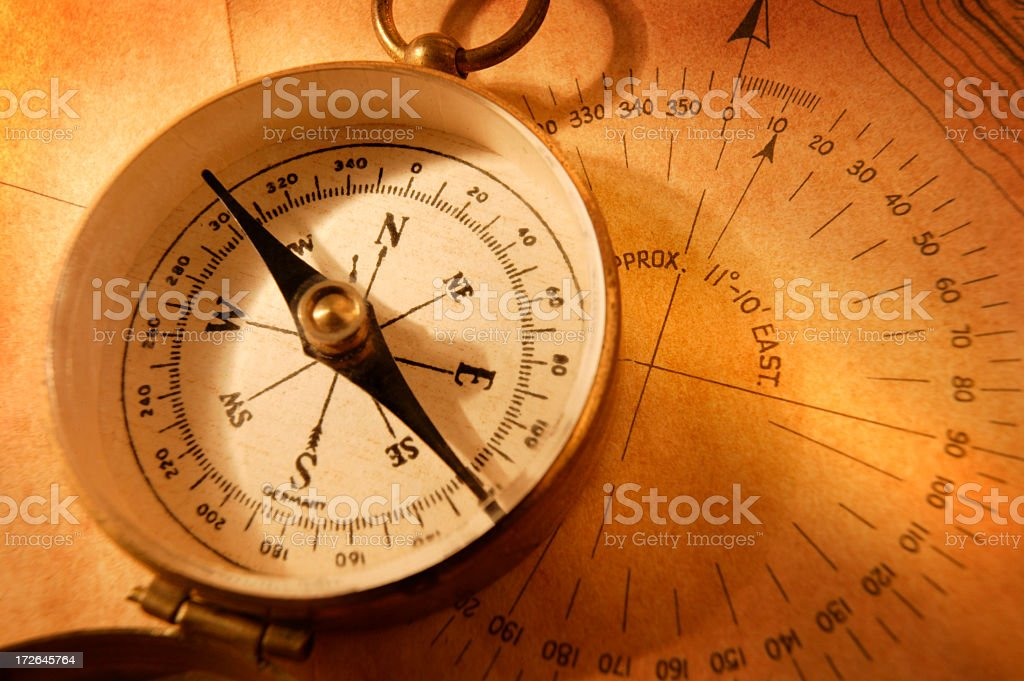 Close Up Of Antique Compass On Map stock photo