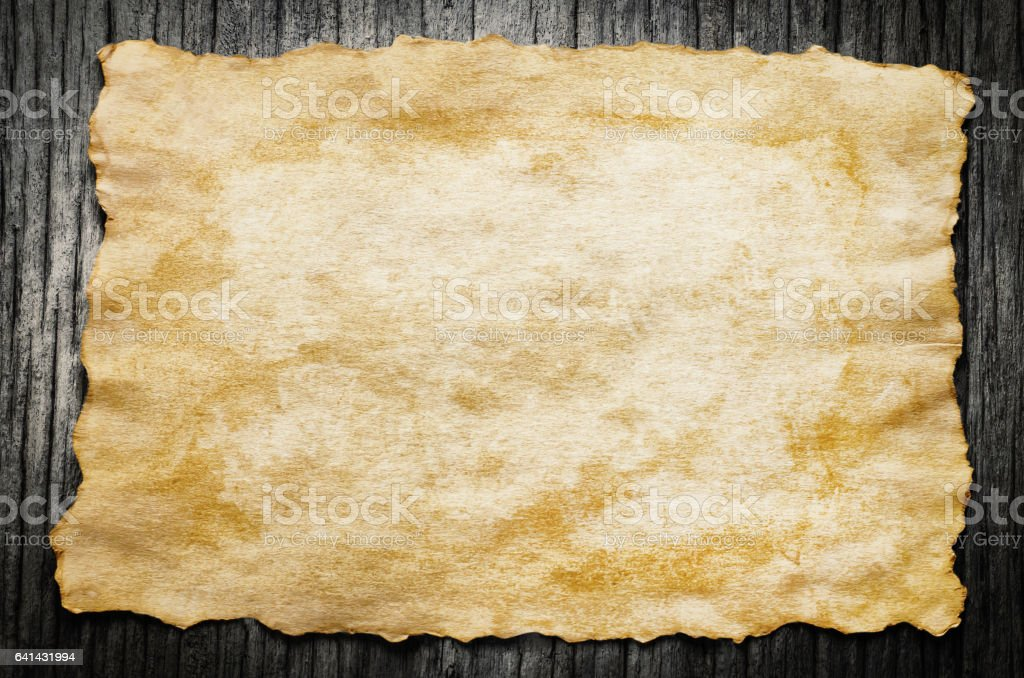 Close up of Antique old paper on wooden background stock photo