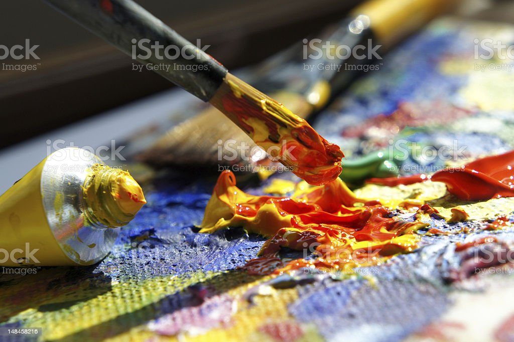 Close up of artist's palette with paint tube and brush stock photo