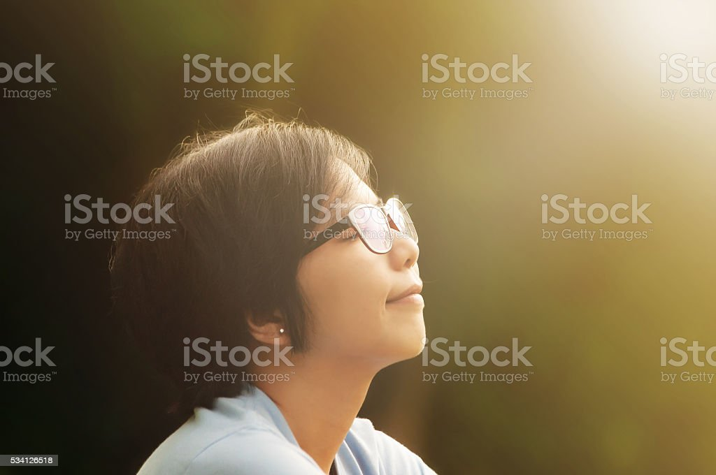 Close up of asian women sitting in a park. stock photo
