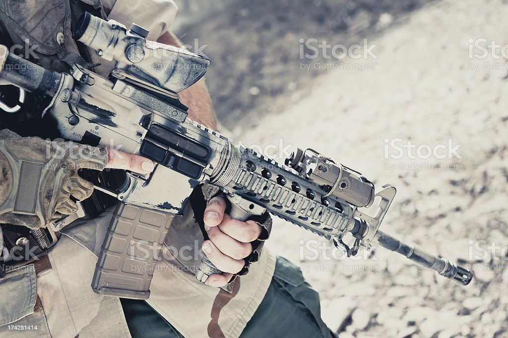 Close up of Assault Rifle Held by Modern Mercenary Soldier royalty-free stock photo