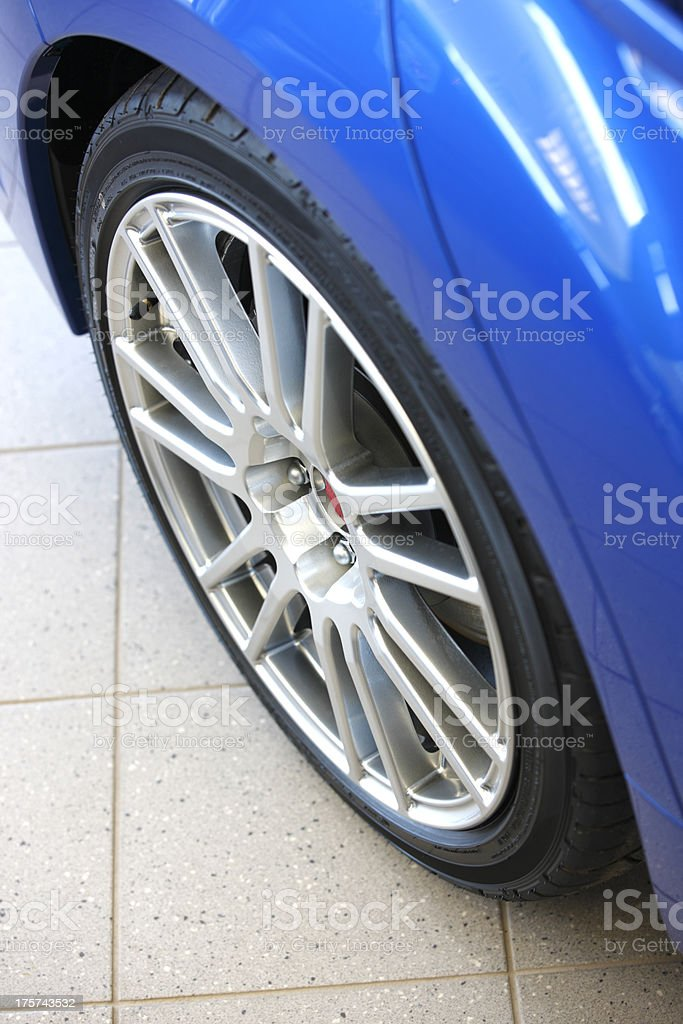 Close up of automobile tire and wheel in showroom. royalty-free stock photo