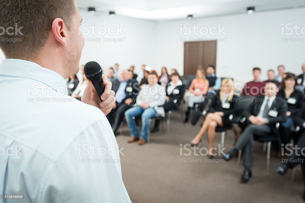 Close up of aYoung Manager with microphone royalty-free stock photo