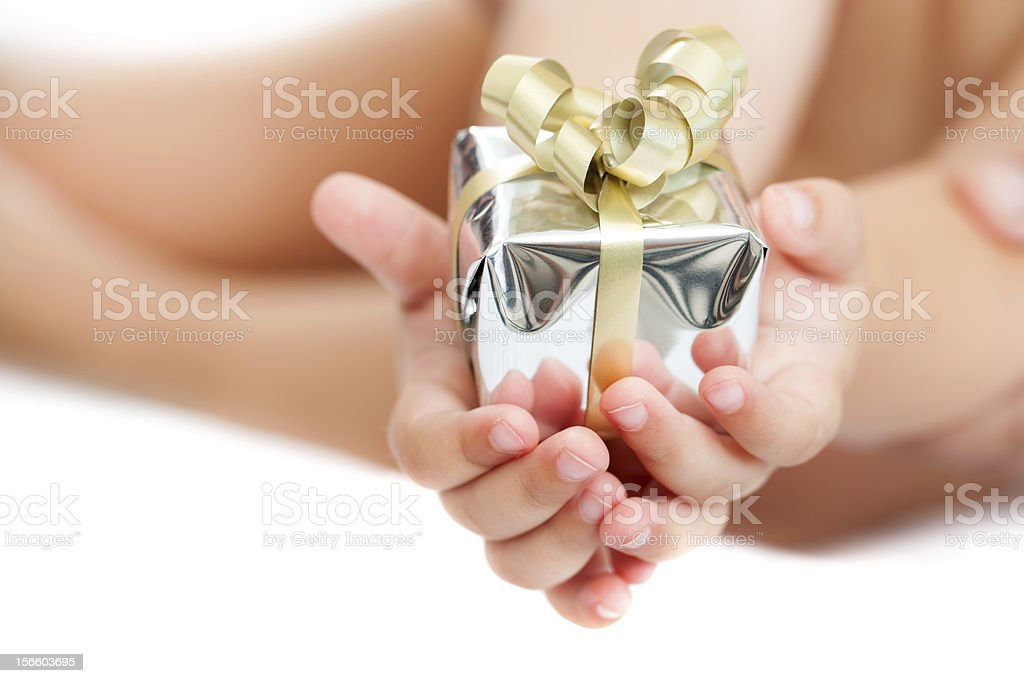 Close up of babies hands holding present. stock photo