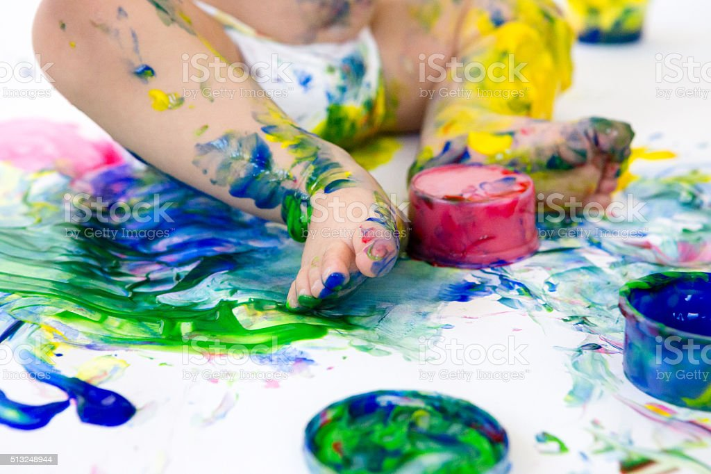 Close up of baby's feet in fingerpaint stock photo