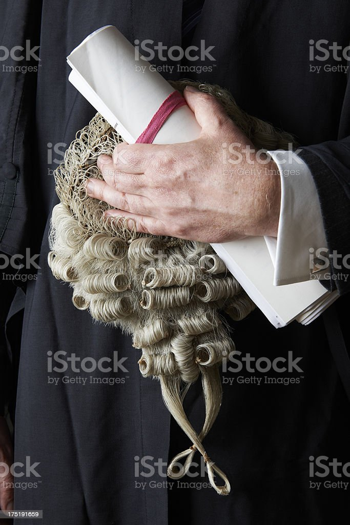 Close Up Of Barrister Holding Brief And Wig stock photo
