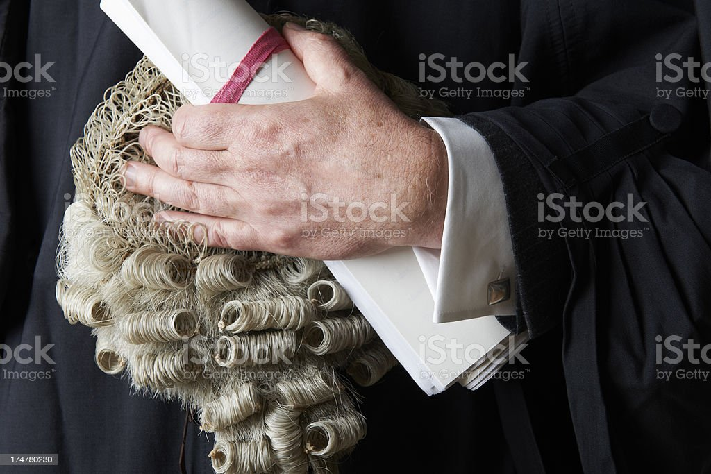 Close Up Of Barrister Holding Wig And Brief stock photo