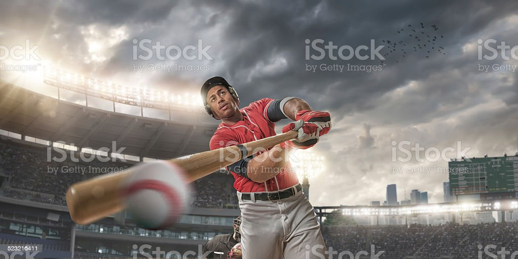 Close Up of Baseball Player Hitting Ball stock photo