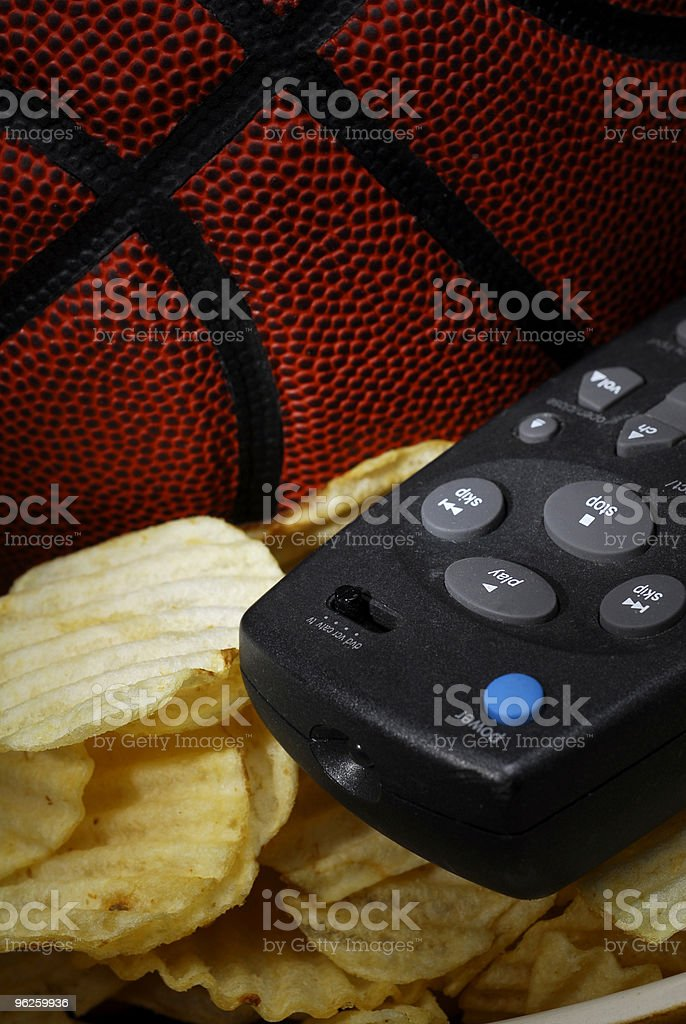 Basketball with chips and remote stock photo