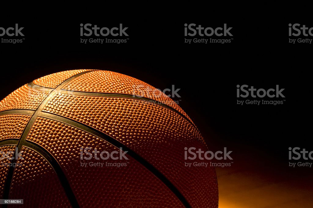 Close up of basketball in low light stock photo