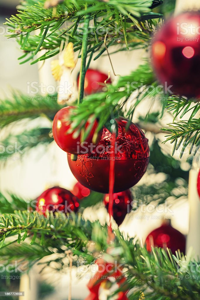 Close up of beautiful christmas tree with red decoration royalty-free stock photo