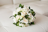Close up of beautiful wedding bouquet on white background