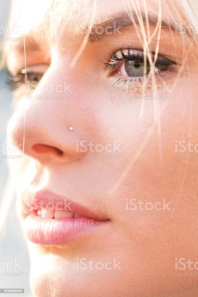 Close up of beautiful woman with piercing on nose. stock photo