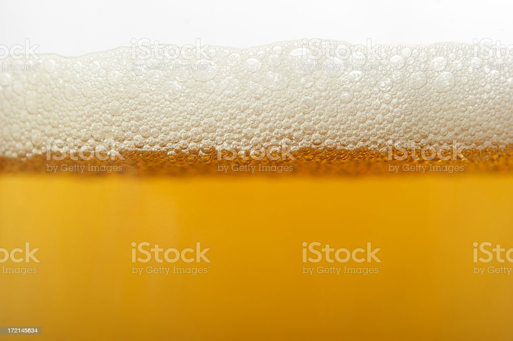 Close up of beer bubbles in glass royalty-free stock photo